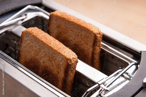 two hot bread toast in toaster
