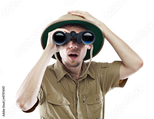 Amazed explorer looking through binoculars Fototapeta