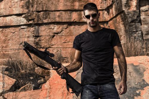 Stampa su Tela man with a shotgun