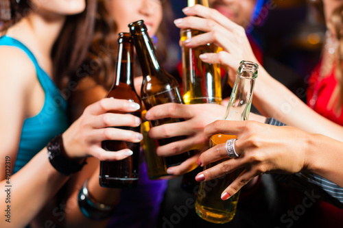 Valokuva People drinking beer in bar or club