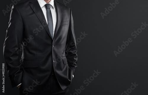 Canvas-taulu Close up of businessman over dark gray background