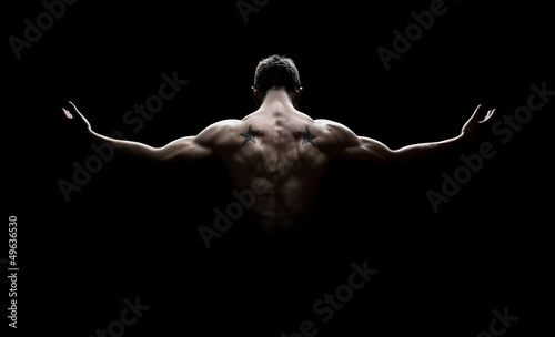 Canvas Print Rear view of healthy young man with arms stretched out
