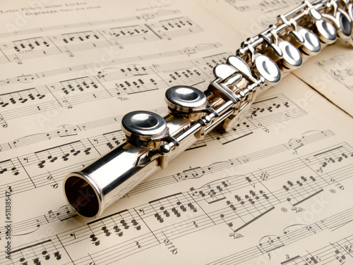 Silver flute on an ancient musical background Fototapeta