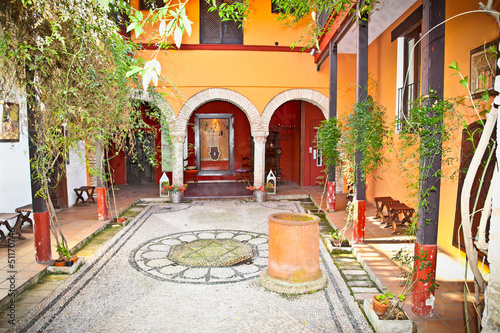 Typical andalusian courtyard In Seville, Spain. Fototapeta