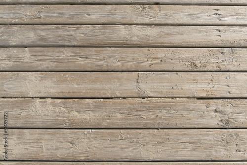 Fotografia Weathered Wooden Boardwalk on Sand