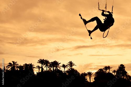 Kiteboarding at sunset. High jump #51540355