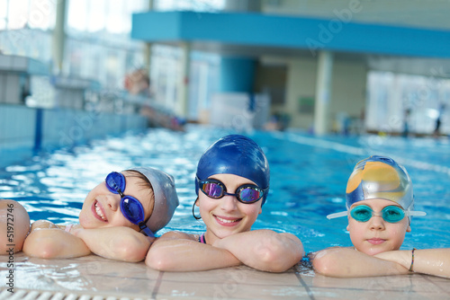 Canvas Print happy children group  at swimming pool