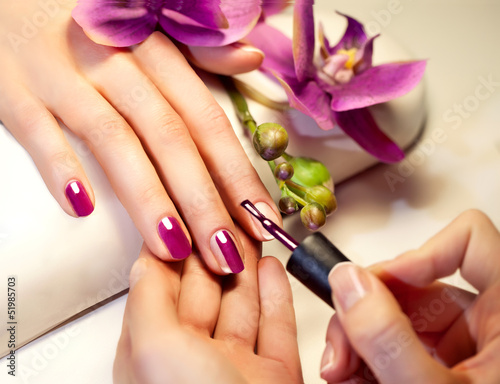 Manicure nail paint pink color