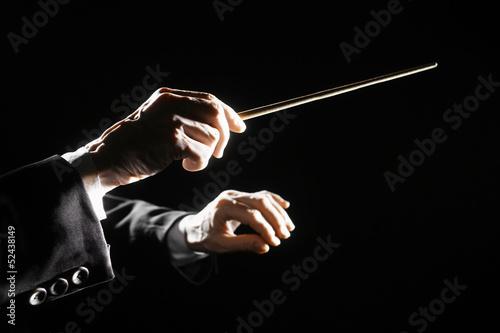 Photo Orchestra conductor hands baton