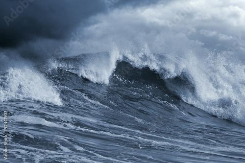 Detailed Atlantic stormy big wave; toned blue, enhanced sky
