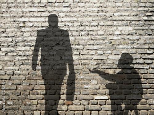 Canvastavla ombres de mendiant et businessman