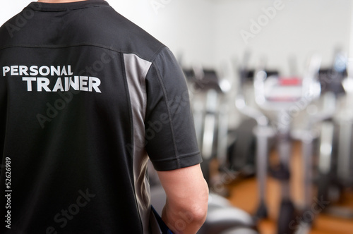 Fototapeta Personal Trainer At The Gym