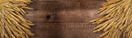 wheat on the wood background. banner