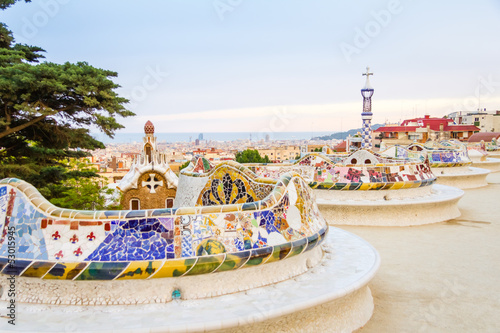 Fotografie, Tablou Colorful mosaic bench of park Guell, designed by Gaudi, in Barce