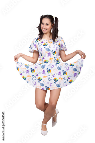 A girl with pigtails in colorful retro dress Fototapeta