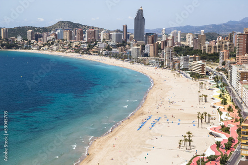 Hotels and beach of Benidorm. Sky and sea.