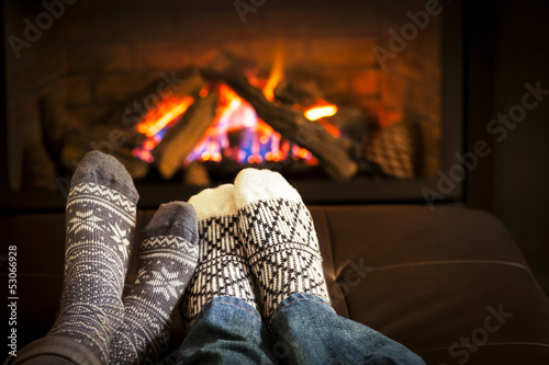 Canvas Print Feet warming by fireplace