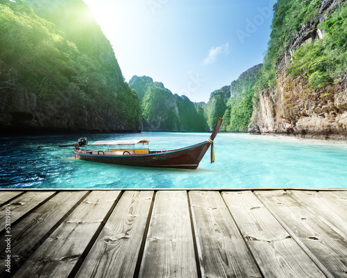 rock of Phi Phi island in Thailand and wooden platform #53119100