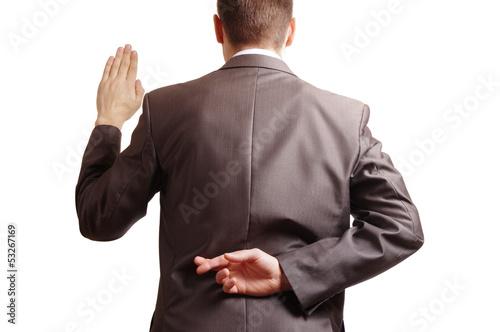Billede på lærred fingers crossed behind a suited backside and one arm raised