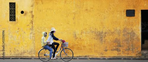 Stampa su Tela Two Girls on Bicycle