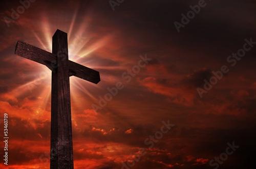 Cuadros en Lienzo Crucifijo en la puesta del sol
