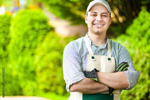 Valokuvatapetti Handsome gardener smiling