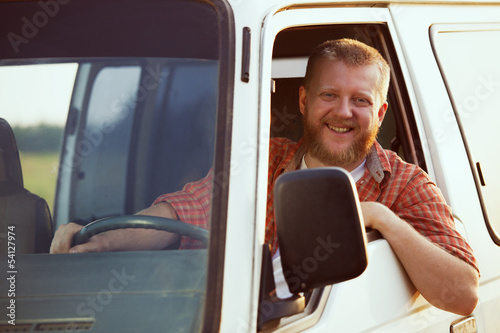Fotografía Jolly driver at the wheel of his car