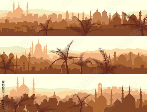 Fotografija Horizontal banners of big arab city at sunset.