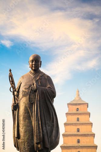monk xuanzang statue with big wild goose pagoda