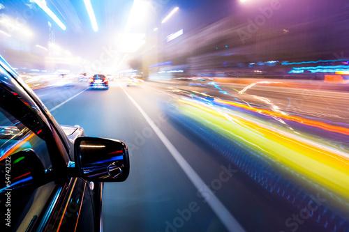 Fototapeta Car driving fast
