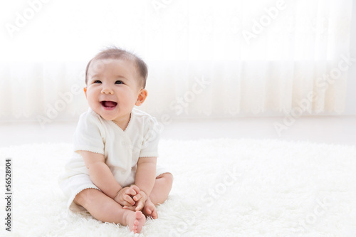 Fotografia, Obraz asian baby relaxing on the carpet