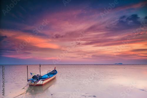 Obraz na plátně A parked boat at sunset in transportation concept