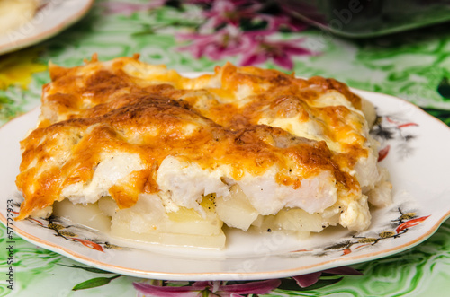 Fish and potatoes baked with cheese