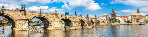 Karlov or charles bridge and river Vltava in Prague in summer Fotobehang