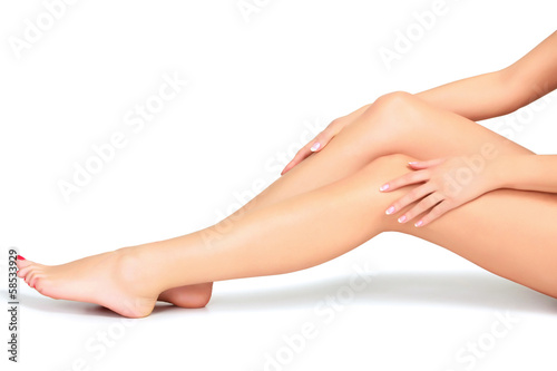 Fotografie, Obraz Woman legs and hands, white background