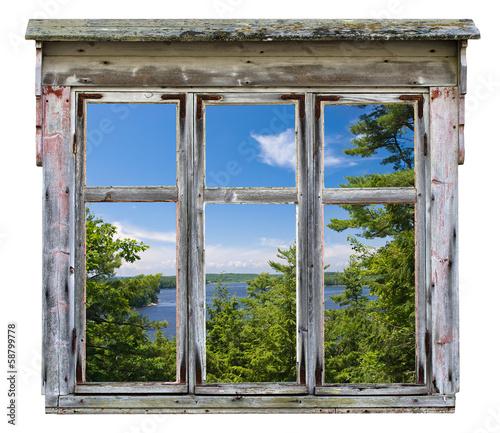 Fototapeta Malowniczy widok widziany przez starą ramę okna ściena
