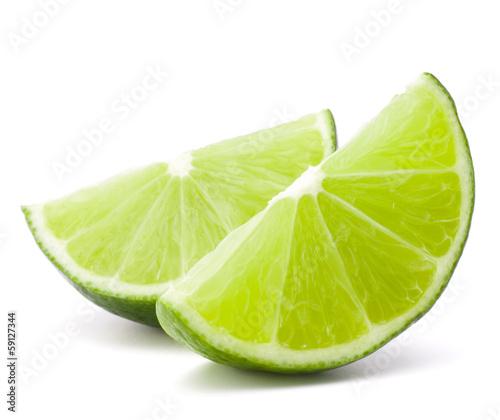 Fotografia Citrus lime fruit segment isolated on white background cutout