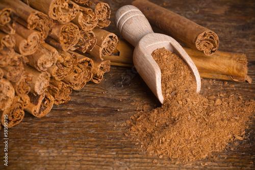 Vászonkép Sticks and ground ceylon cinnamon