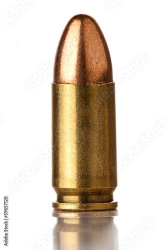 Fototapeta 9mm bullet for a gun isolated on a white background