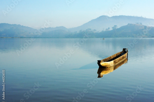 Charming landscape with lonely wooden boat (dug-out canoe ) on l