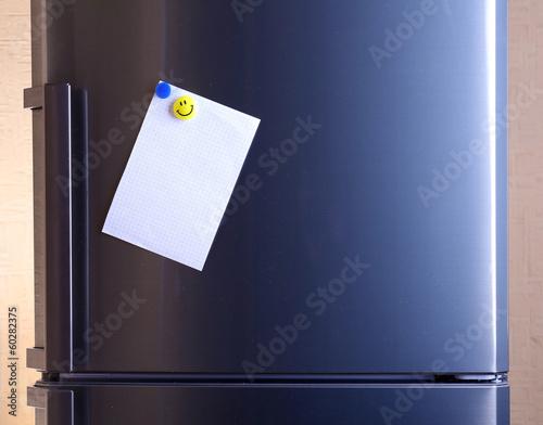 Empty paper sheet on fridge door