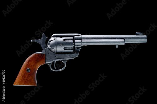 Obraz na plátně revolver pistol isolated on a black background