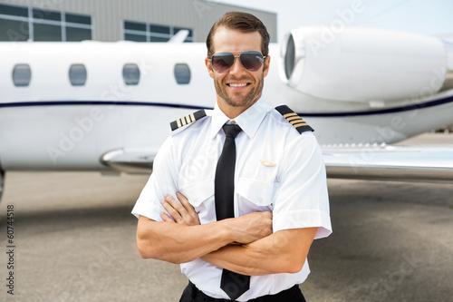 Confident Pilot In Front Of Private Jet Fototapeta