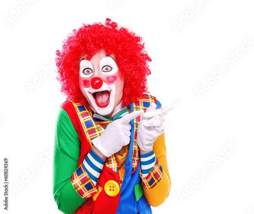 Obraz na płótnie Happy clown pointing to the copy space area