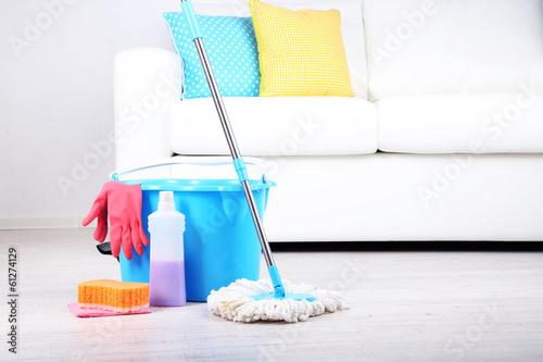 Floor mop and bucket for washing in room Fototapeta