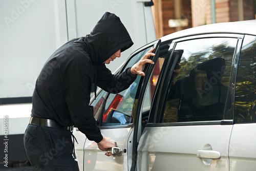 Canvas Print thief burglar at automobile car stealing