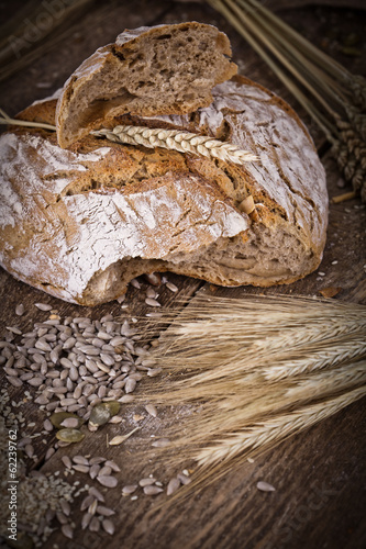 fresh bread and wheat on the wooden - rustic