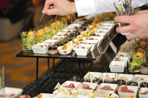 Fotografía Catering stuff arranging finger food