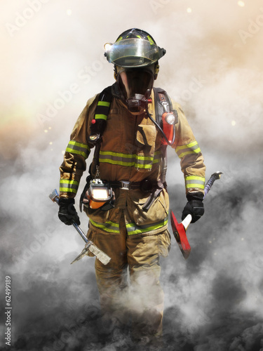 Canvas Print A firefighter pierces through a wall of smoke