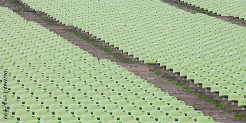 Fototapeta premium Siedziska stadionowe w kolorze zielonym